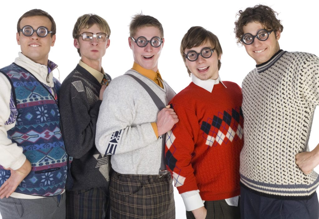 "Group of white men dressed in stereotypical ""nerd"" clothing"