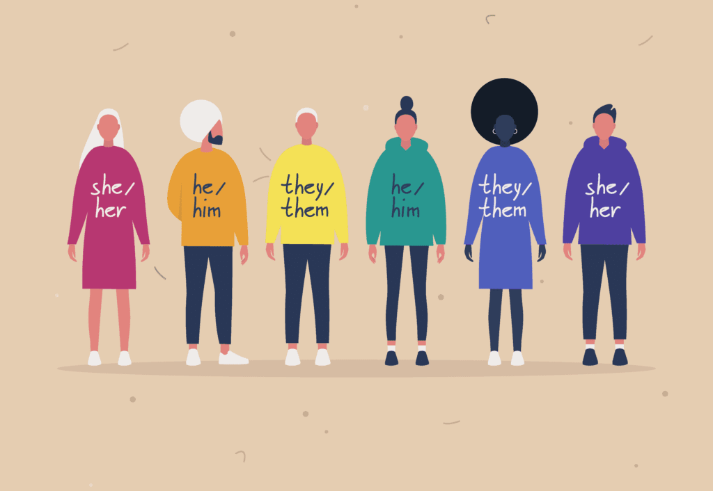 Group of people with Pronouns on their shirts